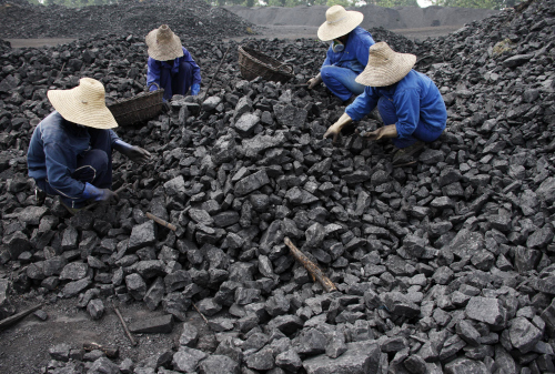 Chinese miners process coal from a mine